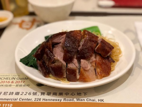 Plate of roast goose noodles with vegetables