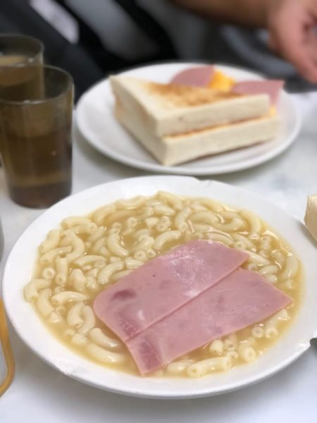 Bowl of macaroni and ham in the foreground and plate of ham toast in the background are popular Hong Kong style breakfast
