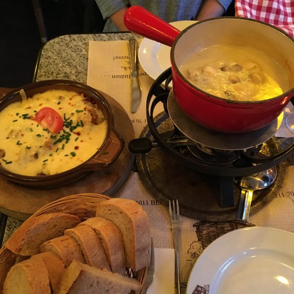 Cheese fondue served with toasted sliced bread is a local delicacy in Switzerland