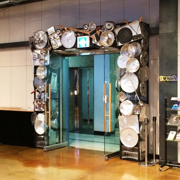 Unique entrance to Nanta Show in Seoul decorated with pots and pans around the door