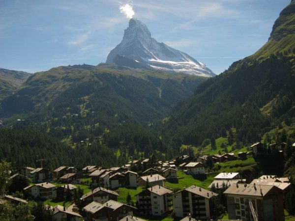 View of mountain village overlooking Switzerland's iconic Matterhorn mountain