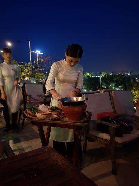 A lady preparing Chả Cá Thăng