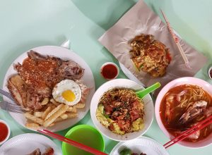 Clockwise to middle: Mixed Grill, Oyster Omelette, Prawn Noodles, 2x Barbecued Chicken Wings, Wanton Noodles
