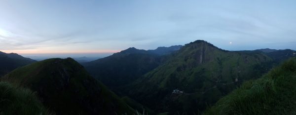 Panoramic view of the sunrise and moonset at Little Adam's Peak