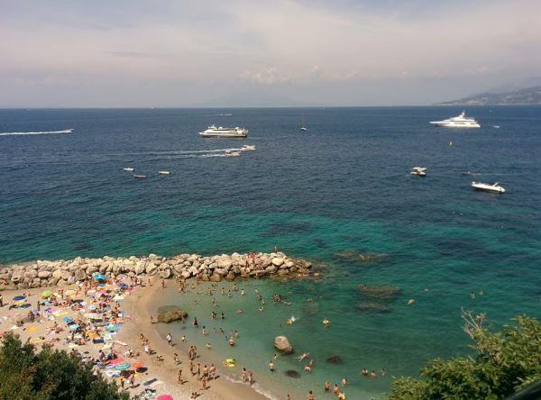 beach overlooking horizon in Capri, a must do when visiting naples, sorrento and capri