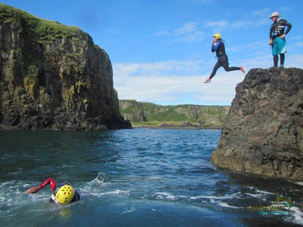 Coasteering off the cliffs into the Irish Sea